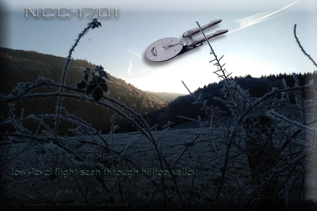 1701 low-level flight scan through hilltop valley